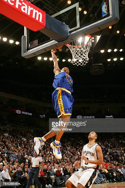 Monta Ellis of the Golden State Warriors goes for the dunk against the San Antonio Spurs on December 11 2007 at Oracle Arena in Oakland California...