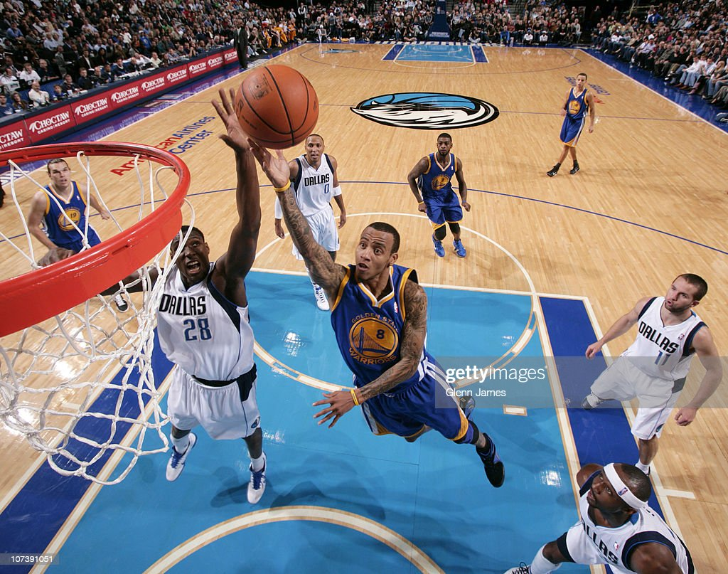 <a gi-track='captionPersonalityLinkClicked' href=/galleries/search?phrase=Monta+Ellis&family=editorial&specificpeople=567403 ng-click='$event.stopPropagation()'>Monta Ellis</a> #8 of the Golden State Warriors goes in for the layup against <a gi-track='captionPersonalityLinkClicked' href=/galleries/search?phrase=Ian+Mahinmi&family=editorial&specificpeople=740196 ng-click='$event.stopPropagation()'>Ian Mahinmi</a> #28 of the Dallas Mavericks during a game on December 7, 2010 at the American Airlines Center in Dallas, Texas.