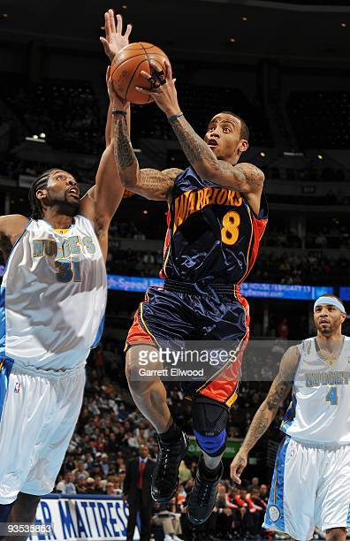 Monta Ellis of the Golden State Warriors goes to the basket against Nene of the Denver Nuggets on December 1 2009 at the Pepsi Center in Denver...