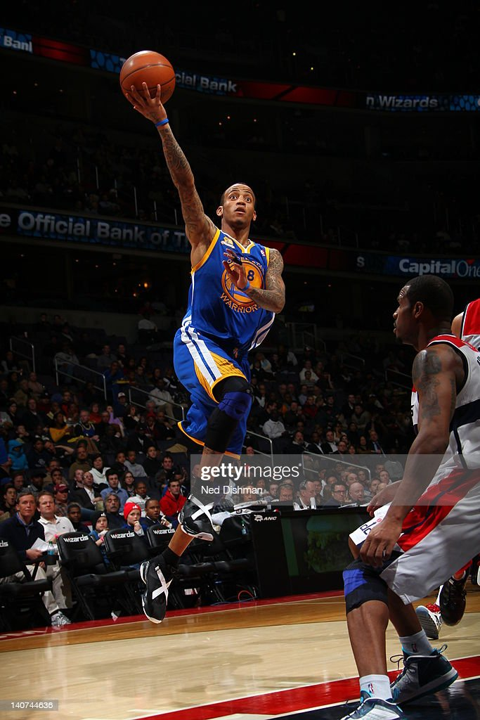 <a gi-track='captionPersonalityLinkClicked' href=/galleries/search?phrase=Monta+Ellis&family=editorial&specificpeople=567403 ng-click='$event.stopPropagation()'>Monta Ellis</a> #8 of the Golden State Warriors goes to the basket during the game between the Washington Wizards and the Golden State Warriors at the Verizon Center on March 5, 2012 in Washington, DC.