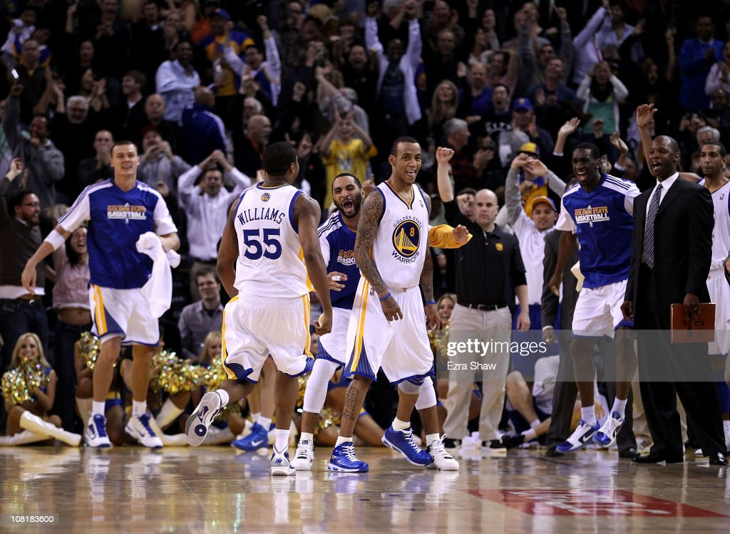 <a gi-track='captionPersonalityLinkClicked' href=/galleries/search?phrase=Monta+Ellis&family=editorial&specificpeople=567403 ng-click='$event.stopPropagation()'>Monta Ellis</a> #8 of the Golden State Warriors is congratulated by teammates after he made the winning shot with 0.6 seconds left in their game againsts the Indiana Pacers at Oracle Arena on January 19, 2011 in Oakland, California.