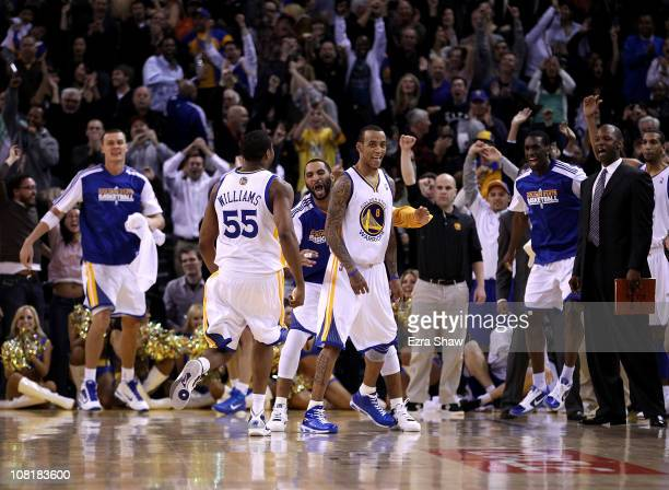 Monta Ellis of the Golden State Warriors is congratulated by teammates after he made the winning shot with 06 seconds left in their game againsts the...