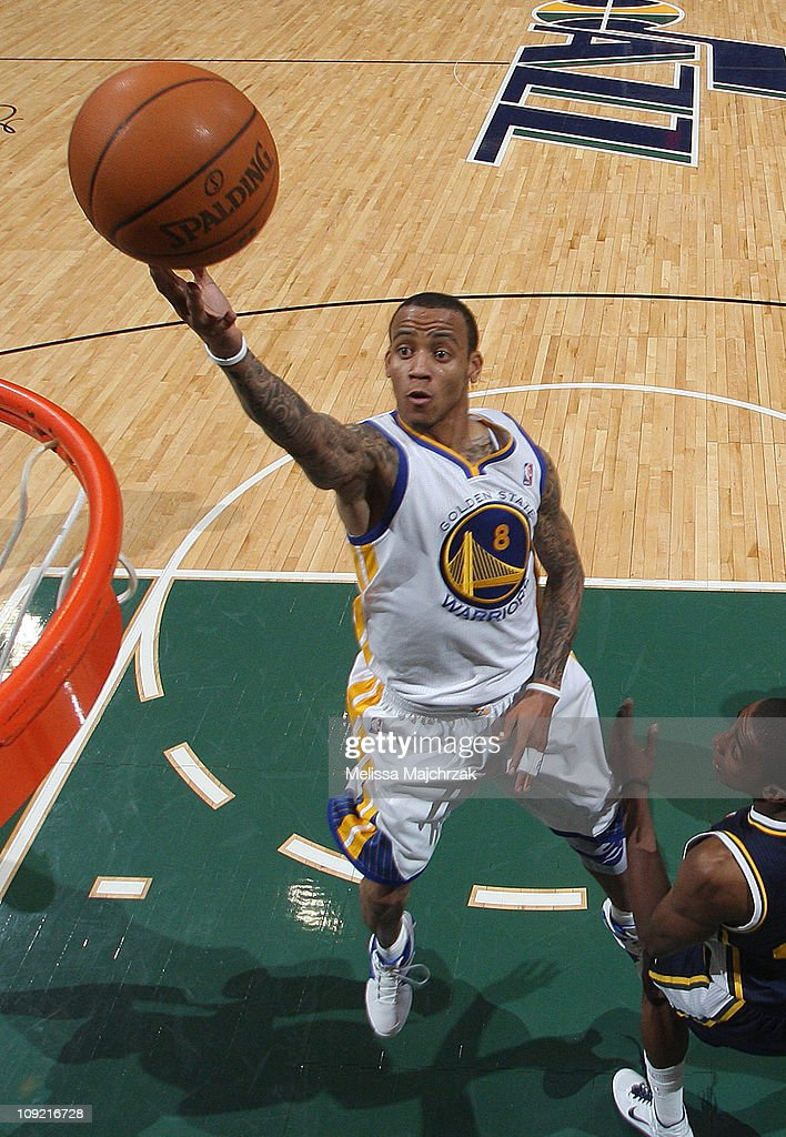 <a gi-track='captionPersonalityLinkClicked' href=/galleries/search?phrase=Monta+Ellis&family=editorial&specificpeople=567403 ng-click='$event.stopPropagation()'>Monta Ellis</a> #8 of the Golden State Warriors lays it up over Jeremy Evans #40 of the Utah Jazz at EnergySolutions Arena on February 16, 2011 in Salt Lake City, Utah.
