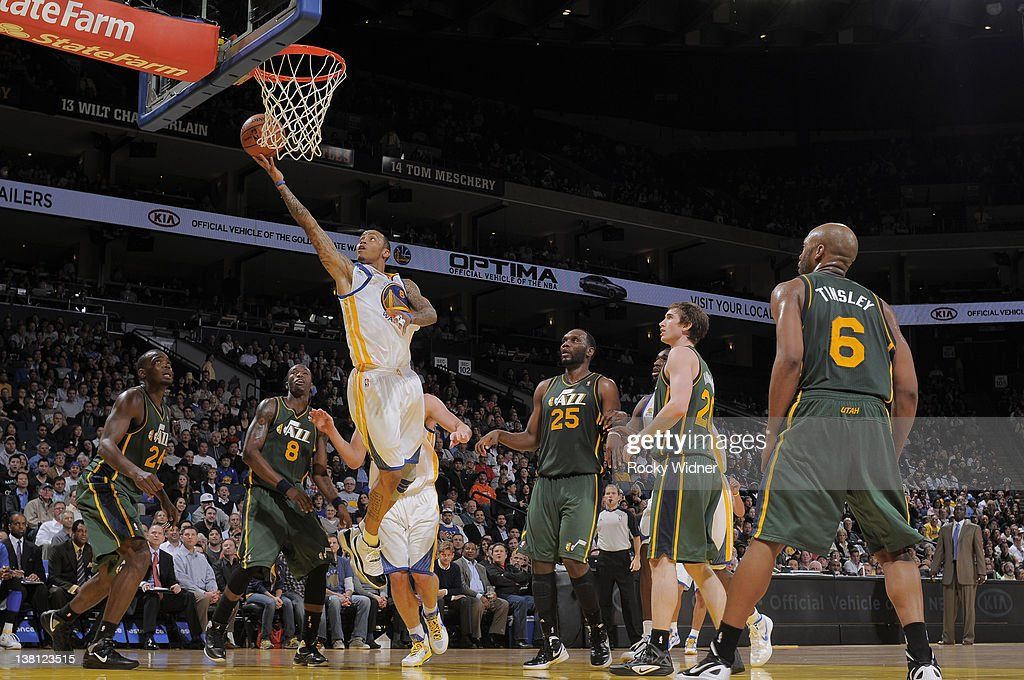 <a gi-track='captionPersonalityLinkClicked' href=/galleries/search?phrase=Monta+Ellis&family=editorial&specificpeople=567403 ng-click='$event.stopPropagation()'>Monta Ellis</a> #8 of the Golden State Warriors lays the ball up against the Utah Jazz defense on February 2, 2012 at Oracle Arena in Oakland, California.