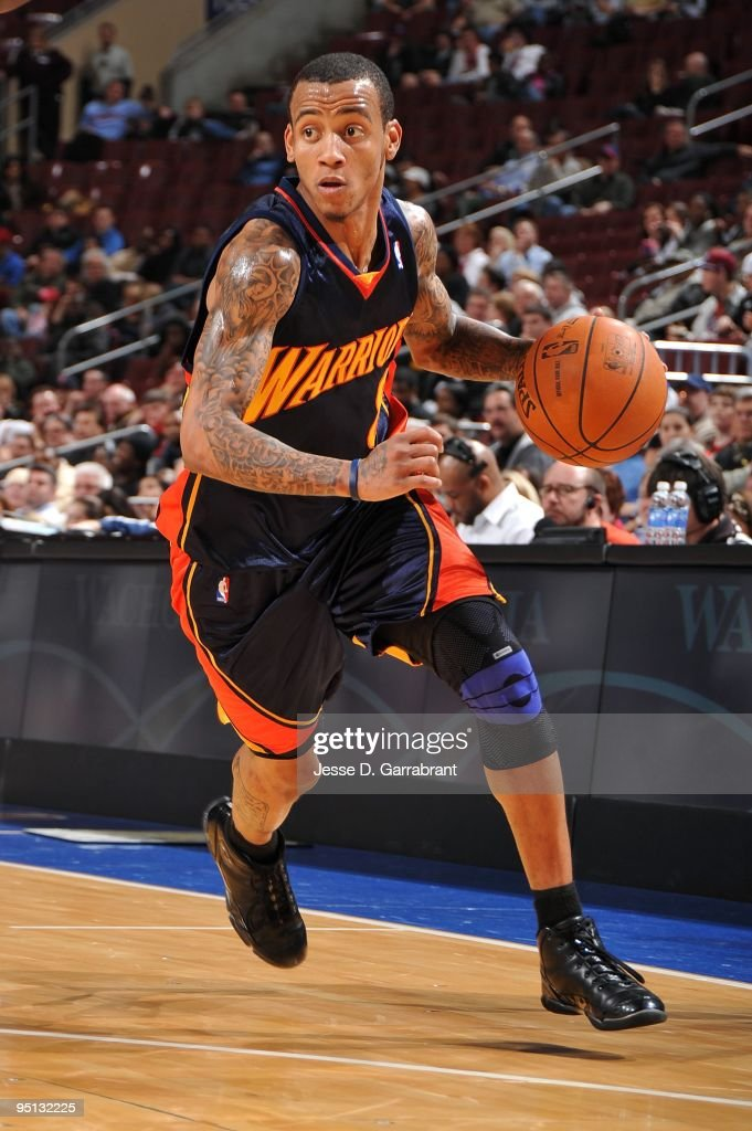 <a gi-track='captionPersonalityLinkClicked' href=/galleries/search?phrase=Monta+Ellis&family=editorial&specificpeople=567403 ng-click='$event.stopPropagation()'>Monta Ellis</a> #8 of the Golden State Warriors moves the ball up court during the game against the Philadelphia 76ers at Wachovia Center on December 14, 2009 in Philadelphia, Pennsylvania. The Sixers won 117-101.