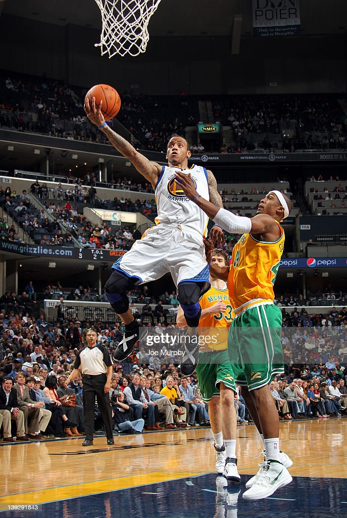 <a gi-track='captionPersonalityLinkClicked' href=/galleries/search?phrase=Monta+Ellis&family=editorial&specificpeople=567403 ng-click='$event.stopPropagation()'>Monta Ellis</a> #8 of the Golden State Warriors shoots a layup against <a gi-track='captionPersonalityLinkClicked' href=/galleries/search?phrase=Dante+Cunningham&family=editorial&specificpeople=683729 ng-click='$event.stopPropagation()'>Dante Cunningham</a> #44 of the Memphis Grizzlies on February 18, 2012 at FedExForum in Memphis, Tennessee.