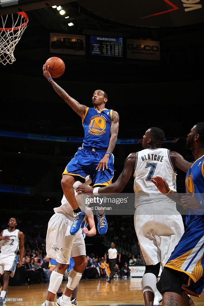 <a gi-track='captionPersonalityLinkClicked' href=/galleries/search?phrase=Monta+Ellis&family=editorial&specificpeople=567403 ng-click='$event.stopPropagation()'>Monta Ellis</a> #8 of the Golden State Warriors shoots against <a gi-track='captionPersonalityLinkClicked' href=/galleries/search?phrase=Andray+Blatche&family=editorial&specificpeople=4282797 ng-click='$event.stopPropagation()'>Andray Blatche</a> #7 of the Washington Wizards at the Verizon Center on March 2, 2011 in Washington, DC.