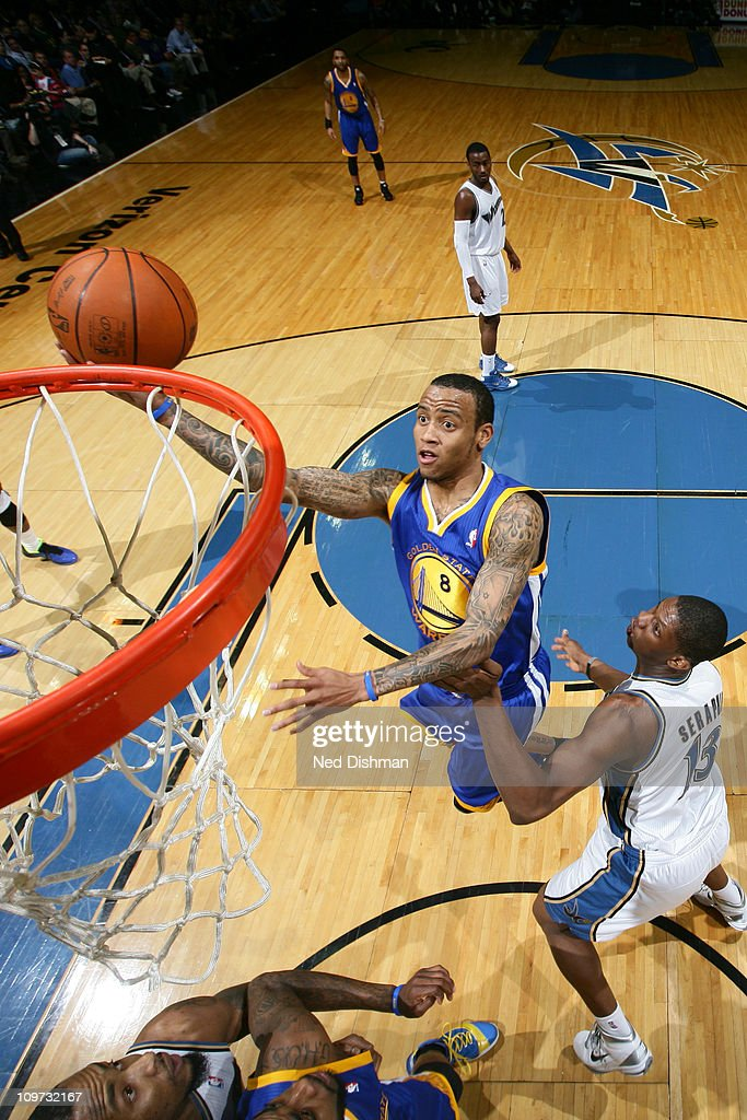 <a gi-track='captionPersonalityLinkClicked' href=/galleries/search?phrase=Monta+Ellis&family=editorial&specificpeople=567403 ng-click='$event.stopPropagation()'>Monta Ellis</a> #8 of the Golden State Warriors shoots against <a gi-track='captionPersonalityLinkClicked' href=/galleries/search?phrase=Kevin+Seraphin&family=editorial&specificpeople=6474998 ng-click='$event.stopPropagation()'>Kevin Seraphin</a> #13 of the Washington Wizards at the Verizon Center on March 2, 2011 in Washington, DC.