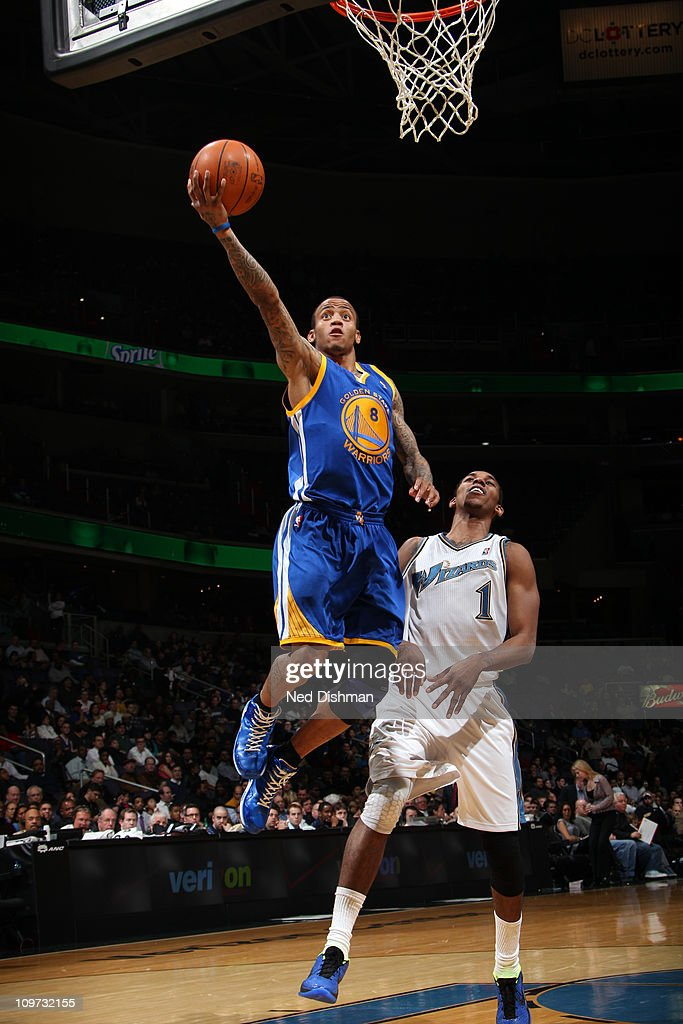 <a gi-track='captionPersonalityLinkClicked' href=/galleries/search?phrase=Monta+Ellis&family=editorial&specificpeople=567403 ng-click='$event.stopPropagation()'>Monta Ellis</a> #8 of the Golden State Warriors shoots against Nick Young #1 of the Washington Wizards at the Verizon Center on March 2, 2011 in Washington, DC.