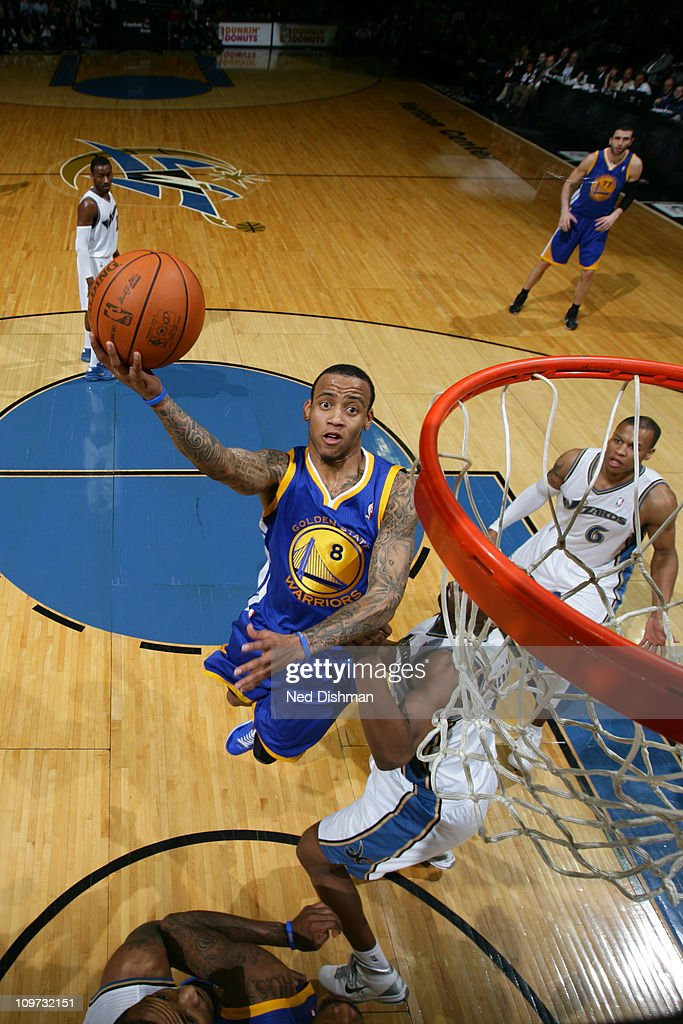 <a gi-track='captionPersonalityLinkClicked' href=/galleries/search?phrase=Monta+Ellis&family=editorial&specificpeople=567403 ng-click='$event.stopPropagation()'>Monta Ellis</a> #8 of the Golden State Warriors shoots against the Washington Wizards at the Verizon Center on March 2, 2011 in Washington, DC.
