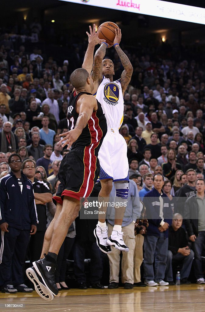 <a gi-track='captionPersonalityLinkClicked' href=/galleries/search?phrase=Monta+Ellis&family=editorial&specificpeople=567403 ng-click='$event.stopPropagation()'>Monta Ellis</a> #8 of the Golden State Warriors shoots over <a gi-track='captionPersonalityLinkClicked' href=/galleries/search?phrase=Shane+Battier&family=editorial&specificpeople=201814 ng-click='$event.stopPropagation()'>Shane Battier</a> #31 of the Miami Heat in overtime at Oracle Arena on January 10, 2012 in Oakland, California.