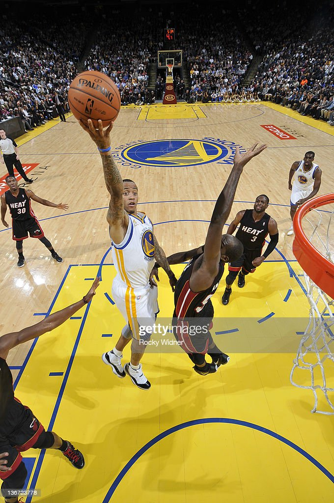 Monta Ellis #8 of the Golden State Warriors slashes to the hoop for a layup against the Miami Heat defense on January 10, 2012 at Oracle Arena in Oakland, California.