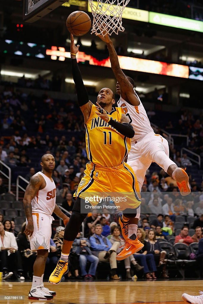 <a gi-track='captionPersonalityLinkClicked' href=/galleries/search?phrase=Monta+Ellis&family=editorial&specificpeople=567403 ng-click='$event.stopPropagation()'>Monta Ellis</a> #11 of the Indiana Pacers lays up a shot past <a gi-track='captionPersonalityLinkClicked' href=/galleries/search?phrase=Archie+Goodwin&family=editorial&specificpeople=9086088 ng-click='$event.stopPropagation()'>Archie Goodwin</a> #20 of the Phoenix Suns during the second half of the NBA game at Talking Stick Resort Arena on January 19, 2016 in Phoenix, Arizona. The Packers defeated the Suns 97-94.