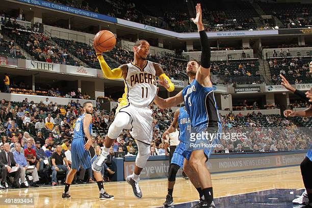 Monta Ellis of the Indiana Pacers looks to pass against the Orlando Magic during a preseason game on October 8 2015 at Bankers Life Fieldhouse in...
