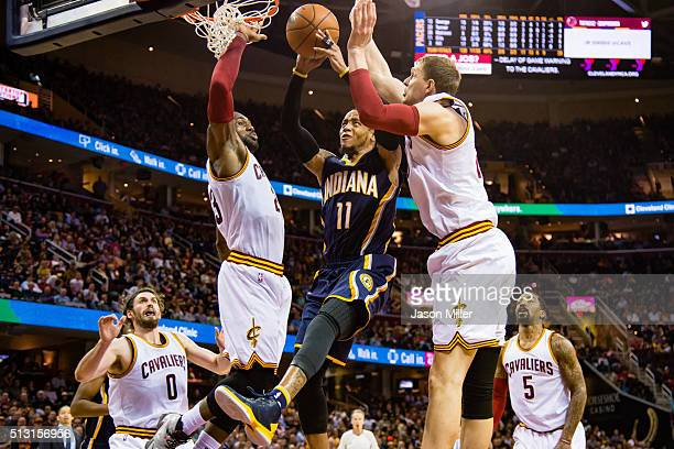 Monta Ellis of the Indiana Pacers shoots over LeBron James and Timofey Mozgov of the Cleveland Cavaliers during the first half at Quicken Loans Arena...