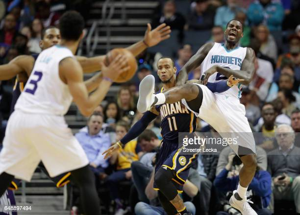 Monta Ellis of the Indiana Pacers tries to stop Marvin Williams of the Charlotte Hornets from getting a pass during their game at Spectrum Center on...