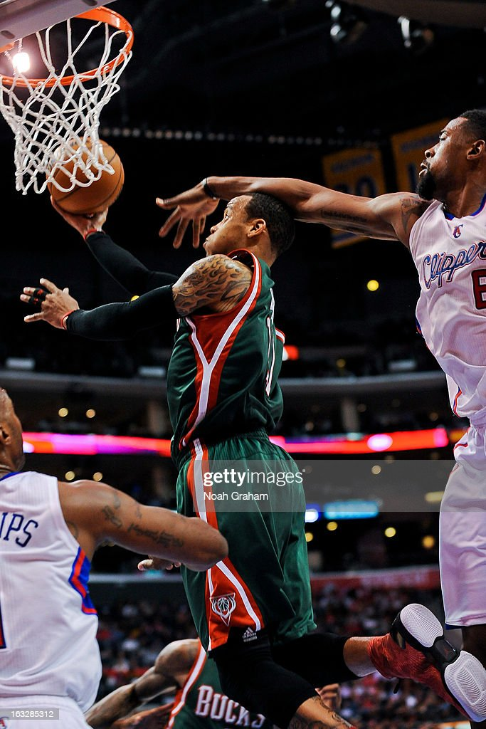 Monta Ellis #11 of the Milwaukee Bucks attempts a layup against DeAndre Jordan #6 of the Los Angeles Clippers at Staples Center on March 6, 2013 in Los Angeles, California.