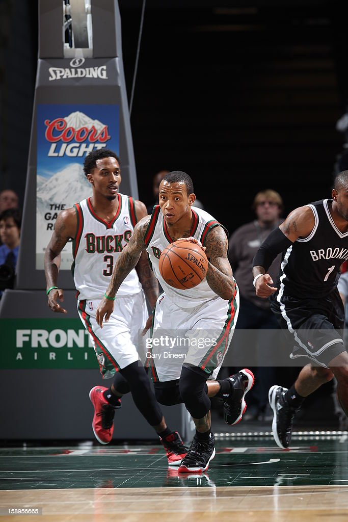 <a gi-track='captionPersonalityLinkClicked' href=/galleries/search?phrase=Monta+Ellis&family=editorial&specificpeople=567403 ng-click='$event.stopPropagation()'>Monta Ellis</a> #11 of the Milwaukee Bucks brings the ball up court against the Brooklyn Nets on December 26, 2012 at the BMO Harris Bradley Center in Milwaukee, Wisconsin.