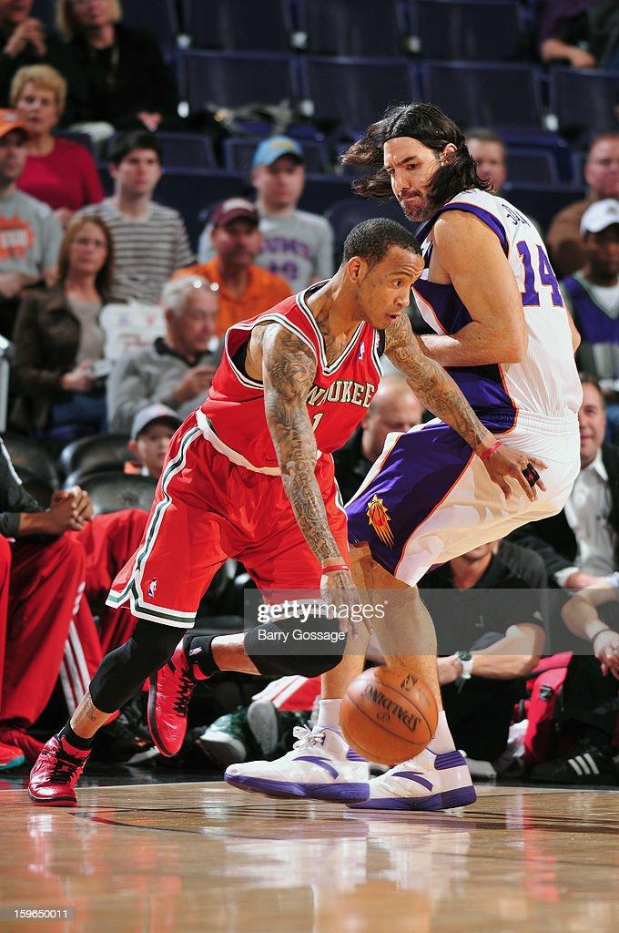 Monta Ellis #11 of the Milwaukee Bucks dribbles around Luis Scola #14 of the Phoenix Suns on January 17, 2013 at U.S. Airways Center in Phoenix, Arizona.