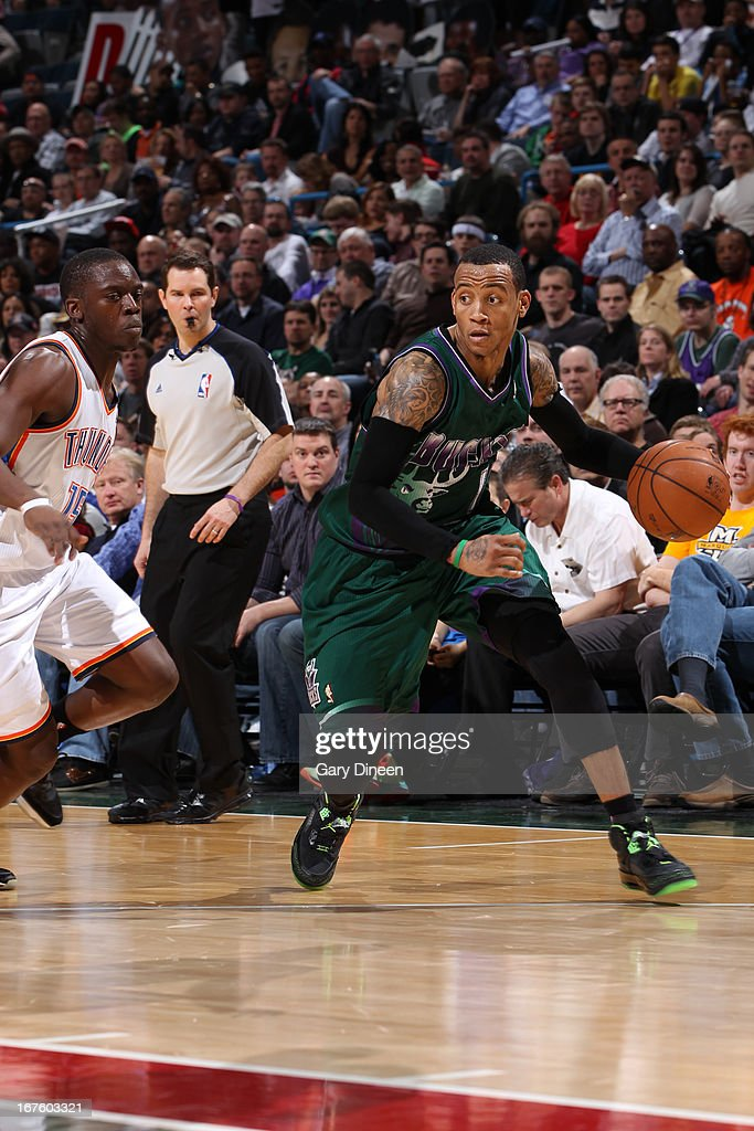 Monta Ellis #11 of the Milwaukee Bucks drives against Reggie Jackson #15 of the Oklahoma City Thunder on March 30, 2013 at the BMO Harris Bradley Center in Milwaukee, Wisconsin.