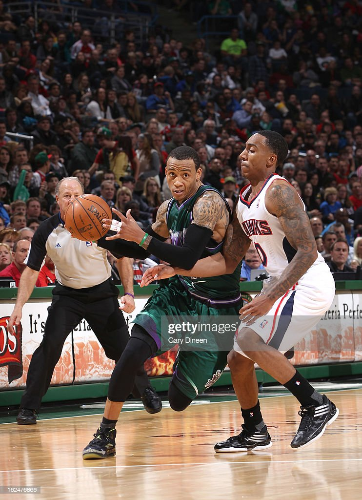 <a gi-track='captionPersonalityLinkClicked' href=/galleries/search?phrase=Monta+Ellis&family=editorial&specificpeople=567403 ng-click='$event.stopPropagation()'>Monta Ellis</a> #11 of the Milwaukee Bucks drives to the basket against <a gi-track='captionPersonalityLinkClicked' href=/galleries/search?phrase=Jeff+Teague&family=editorial&specificpeople=4680498 ng-click='$event.stopPropagation()'>Jeff Teague</a> #0 of the Atlanta Hawks on February 23, 2013 at the BMO Harris Bradley Center in Milwaukee, Wisconsin.