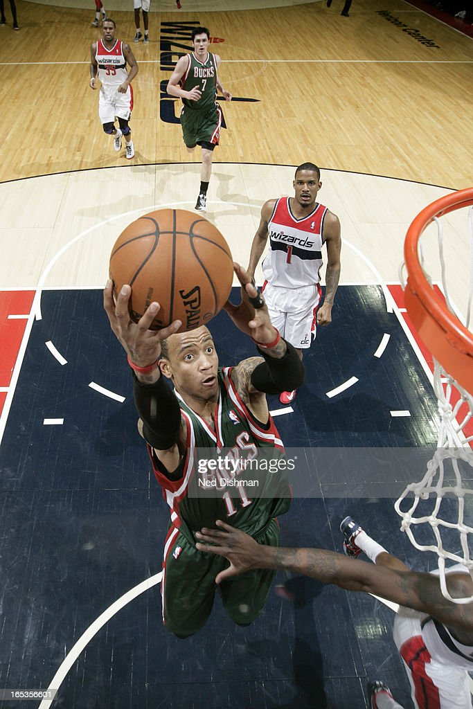 <a gi-track='captionPersonalityLinkClicked' href=/galleries/search?phrase=Monta+Ellis&family=editorial&specificpeople=567403 ng-click='$event.stopPropagation()'>Monta Ellis</a> #11 of the Milwaukee Bucks drives to the basket against the Washington Wizards at the Verizon Center on March 13, 2013 in Washington, DC.