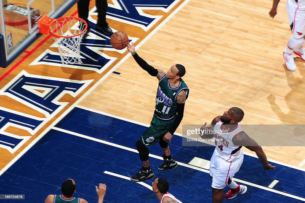 <a gi-track='captionPersonalityLinkClicked' href=/galleries/search?phrase=Monta+Ellis&family=editorial&specificpeople=567403 ng-click='$event.stopPropagation()'>Monta Ellis</a> #11 of the Milwaukee Bucks drives to the basket against the Atlanta Hawks on March 20, 2013 at Philips Arena in Atlanta, Georgia.