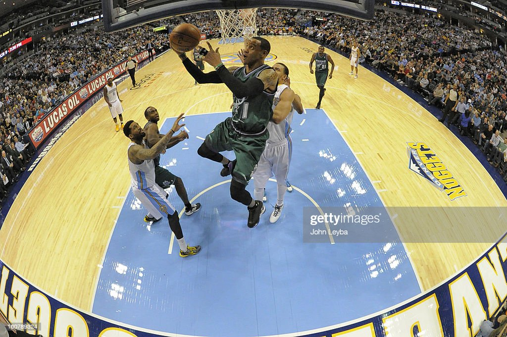 Monta Ellis (11) of the Milwaukee Bucks flies past JaVale McGee (34) of the Denver Nuggets for a reverse layup February 05, 2013 at Pepsi Center. The Denver Nuggets defeated the Milwaukee Bucks 112-104 in NBA action.
