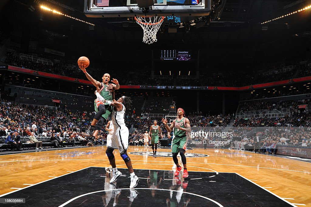 Monta Ellis #11 of the Milwaukee Bucks goes to the basket against Gerald Wallace #45 of the Brooklyn Nets during the game at the Barclays Center on December 9, 2012 in Brooklyn, New York.