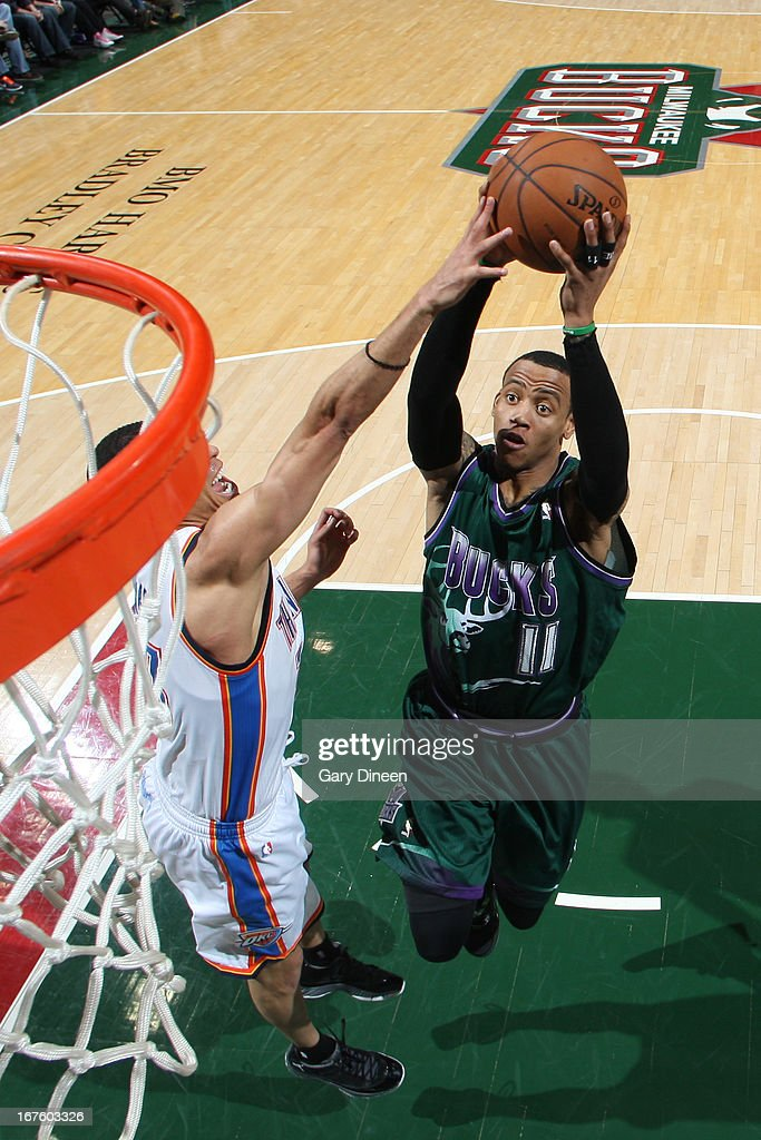 <a gi-track='captionPersonalityLinkClicked' href=/galleries/search?phrase=Monta+Ellis&family=editorial&specificpeople=567403 ng-click='$event.stopPropagation()'>Monta Ellis</a> #11 of the Milwaukee Bucks goes to the basket against the Oklahoma City Thunder on March 30, 2013 at the BMO Harris Bradley Center in Milwaukee, Wisconsin.