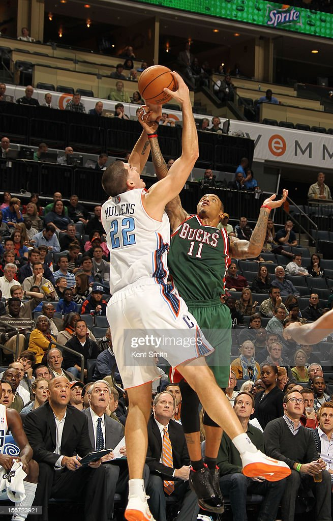 <a gi-track='captionPersonalityLinkClicked' href=/galleries/search?phrase=Monta+Ellis&family=editorial&specificpeople=567403 ng-click='$event.stopPropagation()'>Monta Ellis</a> #11 of the Milwaukee Bucks grabs for the pass against Byron Mullens #22 of the Charlotte Bobcats at the Time Warner Cable Arena on November 19, 2012 in Charlotte, North Carolina.