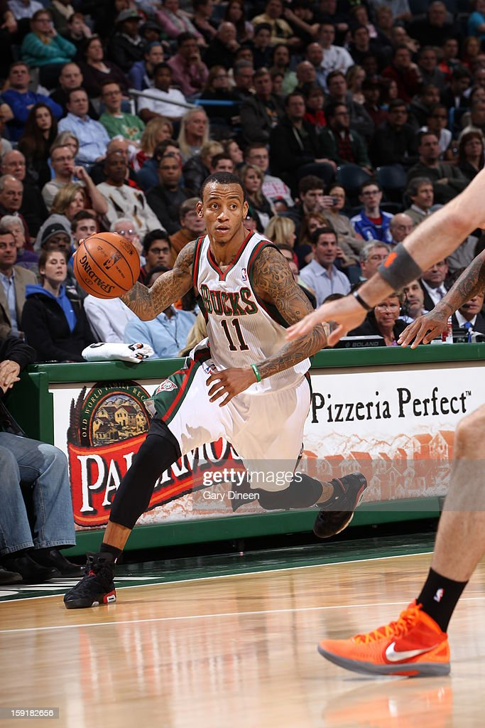 <a gi-track='captionPersonalityLinkClicked' href=/galleries/search?phrase=Monta+Ellis&family=editorial&specificpeople=567403 ng-click='$event.stopPropagation()'>Monta Ellis</a> #11 of the Milwaukee Bucks handles the ball against the Phoenix Suns on January 8, 2013 at the BMO Harris Bradley Center in Milwaukee, Wisconsin.