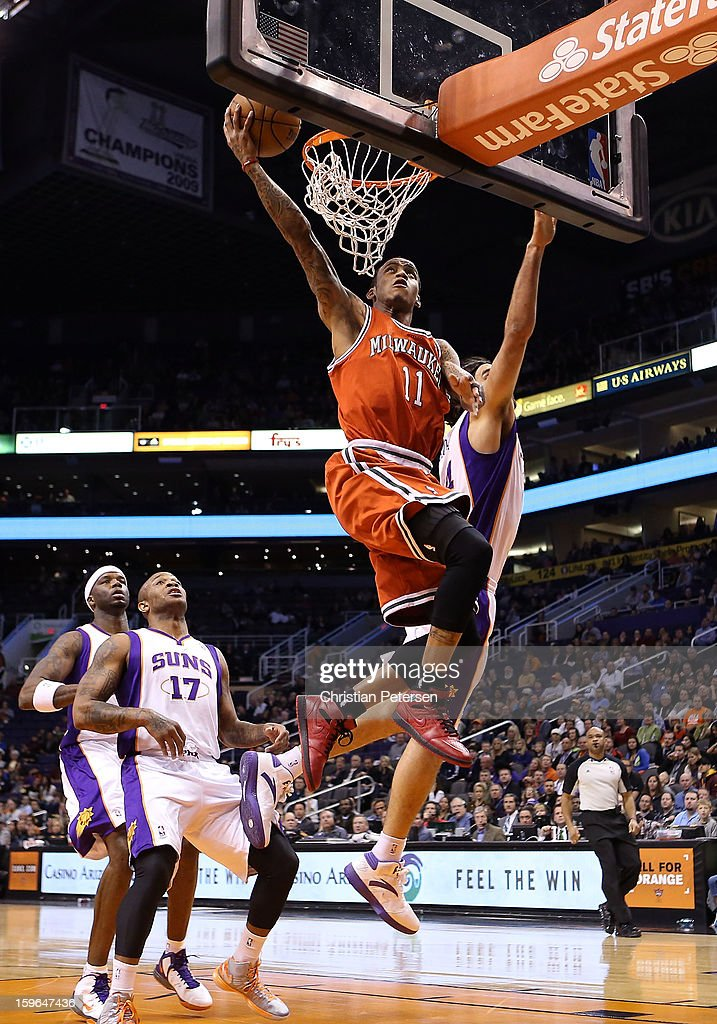 Monta Ellis #11 of the Milwaukee Bucks lays up a shot against the Phoenix Suns during the NBA game at US Airways Center on January 17, 2013 in Phoenix, Arizona.
