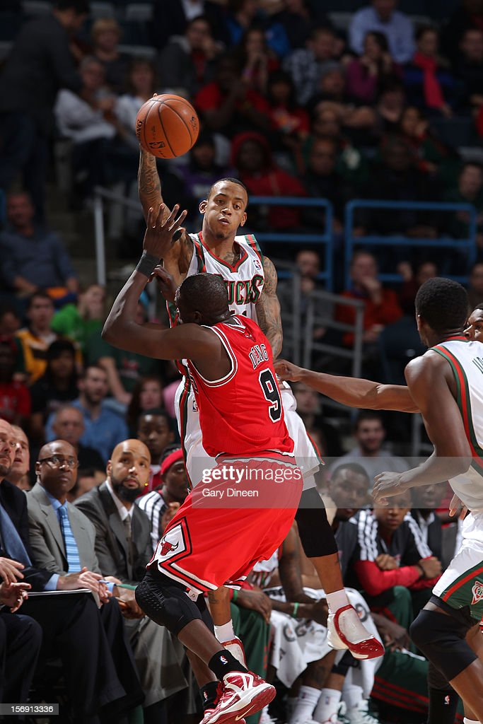 Monta Ellis #11 of the Milwaukee Bucks passes against Luol Deng #9 of the Chicago Bulls during the NBA game on November 24, 2012 at the BMO Harris Bradley Center in Milwaukee, Wisconsin.