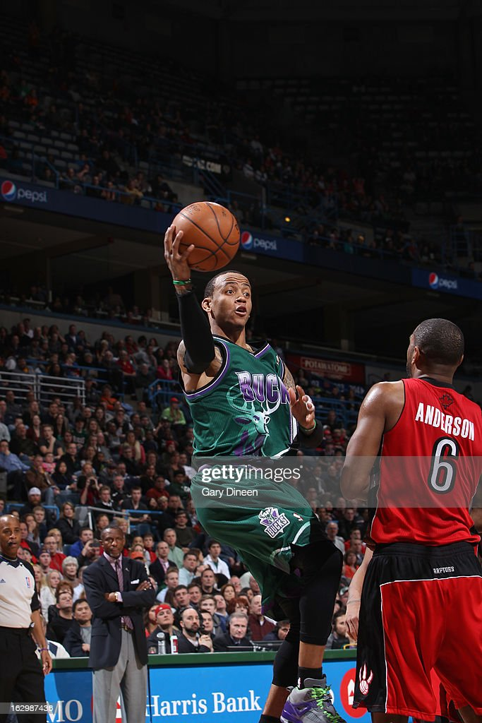 <a gi-track='captionPersonalityLinkClicked' href=/galleries/search?phrase=Monta+Ellis&family=editorial&specificpeople=567403 ng-click='$event.stopPropagation()'>Monta Ellis</a> #11 of the Milwaukee Bucks passes the ball against <a gi-track='captionPersonalityLinkClicked' href=/galleries/search?phrase=Alan+Anderson&family=editorial&specificpeople=3945355 ng-click='$event.stopPropagation()'>Alan Anderson</a> #6 of the Toronto Raptors on March 2, 2013 at the BMO Harris Bradley Center in Milwaukee, Wisconsin.