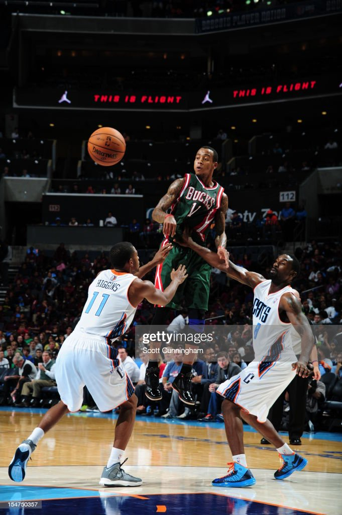 <a gi-track='captionPersonalityLinkClicked' href=/galleries/search?phrase=Monta+Ellis&family=editorial&specificpeople=567403 ng-click='$event.stopPropagation()'>Monta Ellis</a> #11 of the Milwaukee Bucks passes the ball against Cory Higgins #11 of the Charlotte Bobcats at the Time Warner Cable Arena on October 25, 2012 in Charlotte, North Carolina.
