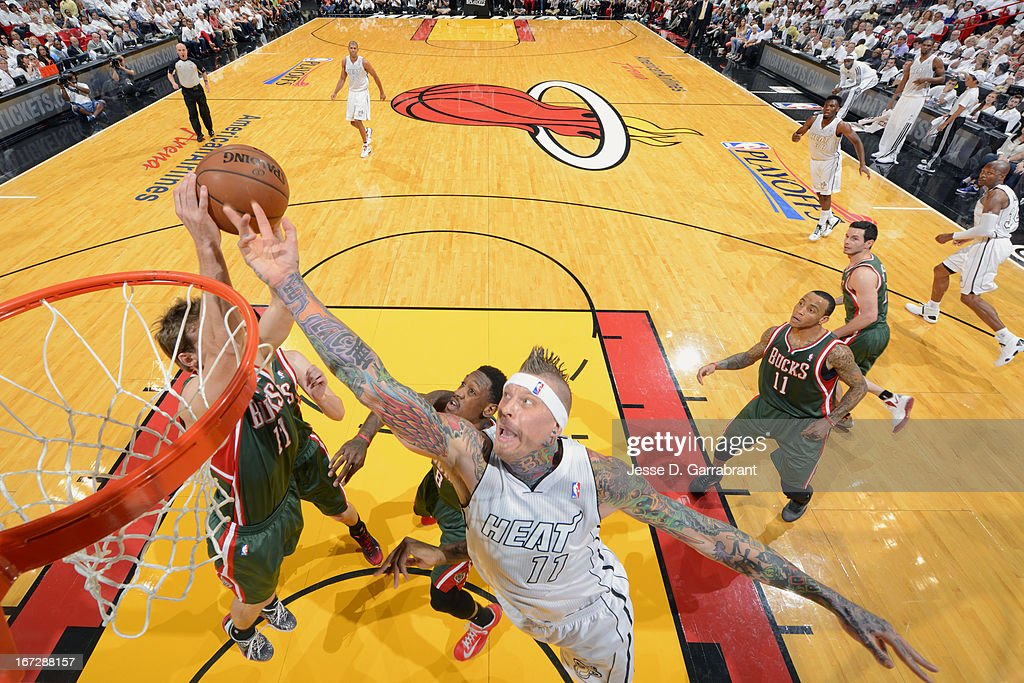 Monta Ellis #11 of the Milwaukee Bucks reaches for a rebound against Chris Andersen #11 of the Miami Heat in Game Two of the Eastern Conference Quarterfinals during the 2013 NBA Playoffs on April 23, 2013 at American Airlines Arena in Miami, Florida.