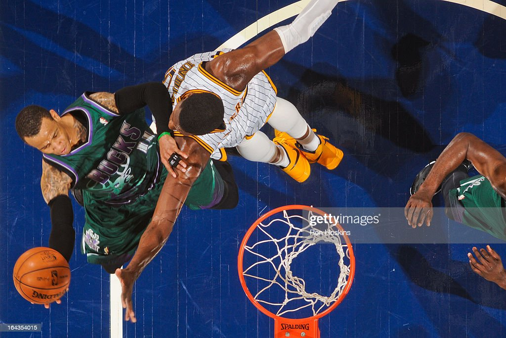 Monta Ellis #11 of the Milwaukee Bucks shoots a layup against Roy Hibbert #55 of the Indiana Pacers on March 22, 2013 at Bankers Life Fieldhouse in Indianapolis, Indiana.
