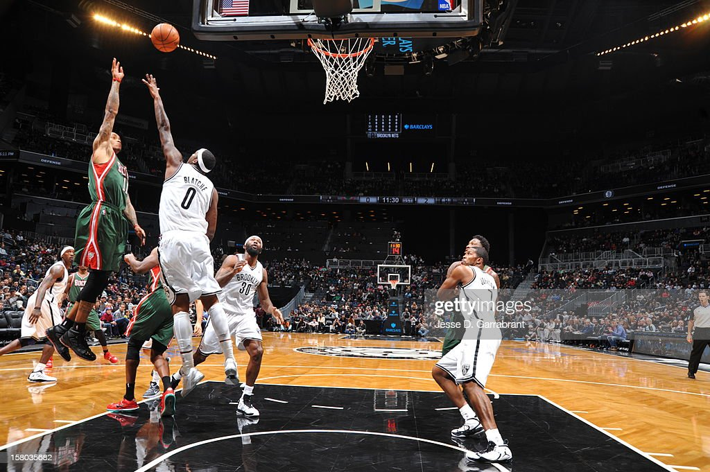 Monta Ellis #11 of the Milwaukee Bucks shoots against Andray Blatche #0 of the Brooklyn Nets during the game at the Barclays Center on December 9, 2012 in Brooklyn, New York.