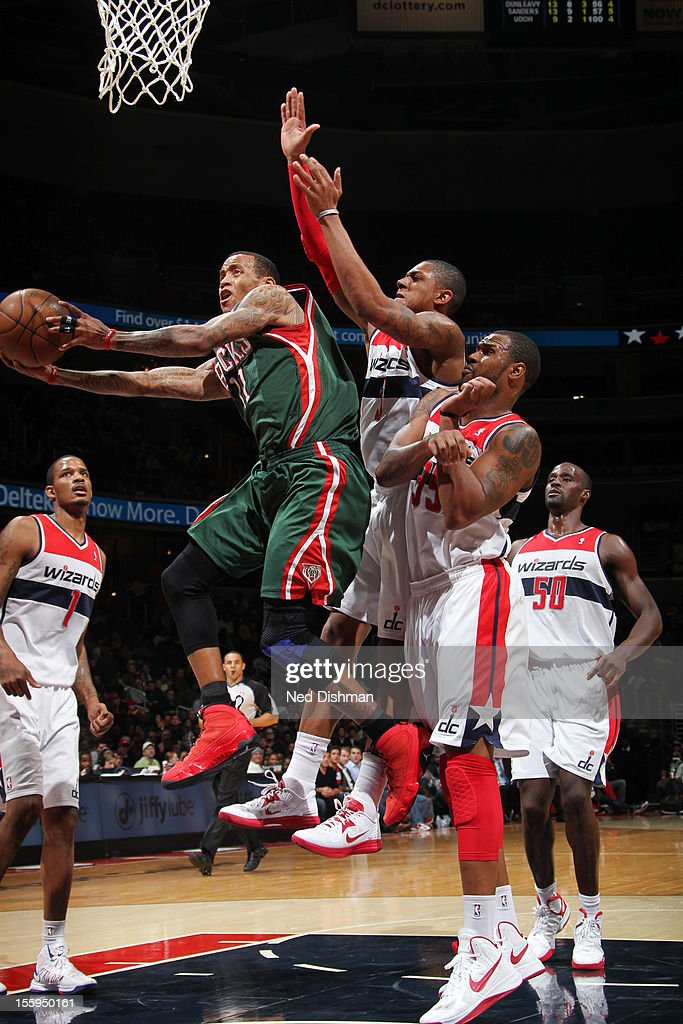<a gi-track='captionPersonalityLinkClicked' href=/galleries/search?phrase=Monta+Ellis&family=editorial&specificpeople=567403 ng-click='$event.stopPropagation()'>Monta Ellis</a> #11 of the Milwaukee Bucks shoots against <a gi-track='captionPersonalityLinkClicked' href=/galleries/search?phrase=Bradley+Beal&family=editorial&specificpeople=7640439 ng-click='$event.stopPropagation()'>Bradley Beal</a> #3 of the Washington Wizards during the game at the Verizon Center on November 9, 2012 in Washington, DC.