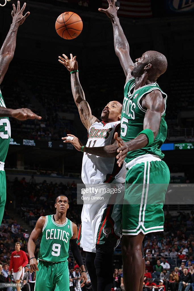 Monta Ellis #11 of the Milwaukee Bucks shoots against (L-R) Brandon Bass #30 and Kevin Garnett #5 of the Boston Celtics during the NBA game on November 10, 2012 at the BMO Harris Bradley Center in Milwaukee, Wisconsin.