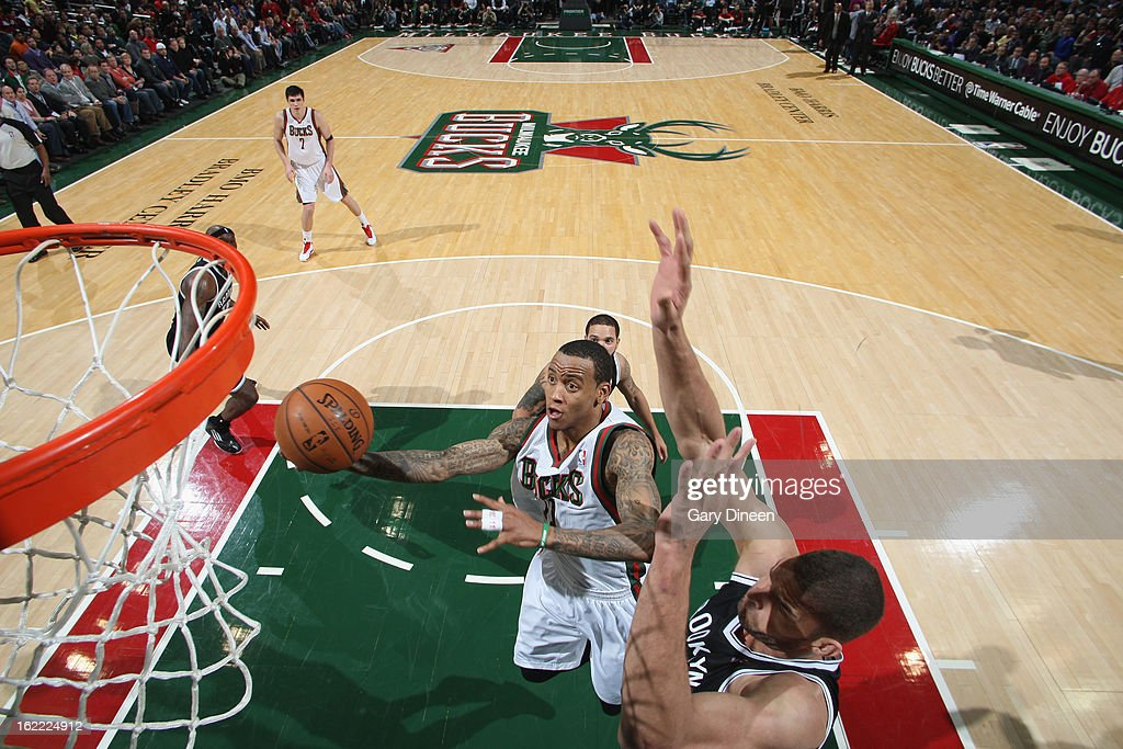 <a gi-track='captionPersonalityLinkClicked' href=/galleries/search?phrase=Monta+Ellis&family=editorial&specificpeople=567403 ng-click='$event.stopPropagation()'>Monta Ellis</a> #11 of the Milwaukee Bucks shoots against <a gi-track='captionPersonalityLinkClicked' href=/galleries/search?phrase=Brook+Lopez&family=editorial&specificpeople=3847328 ng-click='$event.stopPropagation()'>Brook Lopez</a> #11 of the Brooklyn Nets on February 20, 2013 at the BMO Harris Bradley Center in Milwaukee, Wisconsin.