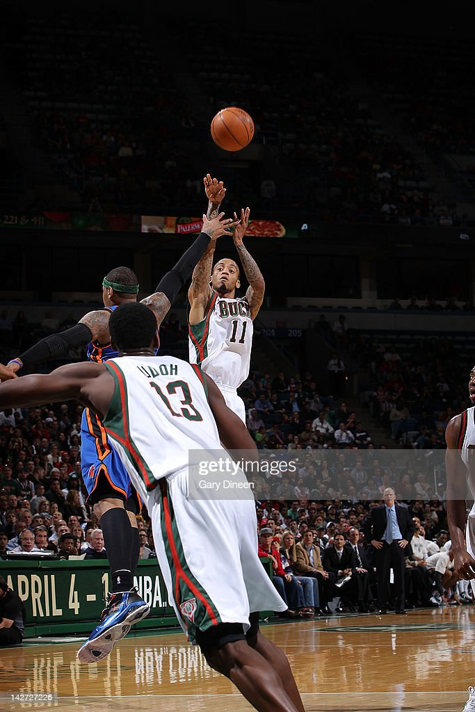 <a gi-track='captionPersonalityLinkClicked' href=/galleries/search?phrase=Monta+Ellis&family=editorial&specificpeople=567403 ng-click='$event.stopPropagation()'>Monta Ellis</a> #11 of the Milwaukee Bucks shoots against <a gi-track='captionPersonalityLinkClicked' href=/galleries/search?phrase=Carmelo+Anthony&family=editorial&specificpeople=201494 ng-click='$event.stopPropagation()'>Carmelo Anthony</a> #7 of the New York Knicks on April 11, 2012 at the Bradley Center in Milwaukee, Wisconsin.