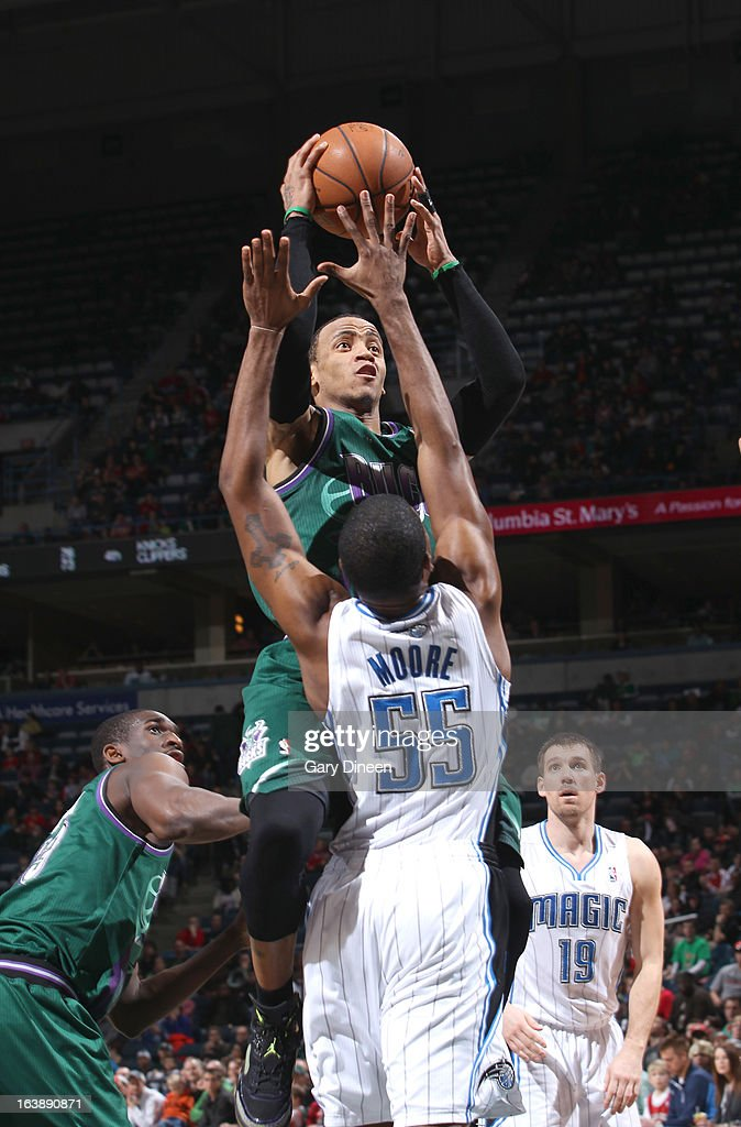 <a gi-track='captionPersonalityLinkClicked' href=/galleries/search?phrase=Monta+Ellis&family=editorial&specificpeople=567403 ng-click='$event.stopPropagation()'>Monta Ellis</a> #11 of the Milwaukee Bucks shoots against <a gi-track='captionPersonalityLinkClicked' href=/galleries/search?phrase=E%27Twaun+Moore&family=editorial&specificpeople=4877476 ng-click='$event.stopPropagation()'>E'Twaun Moore</a> #55 of the Orlando Magic on March 17, 2013 at the BMO Harris Bradley Center in Milwaukee, Wisconsin.