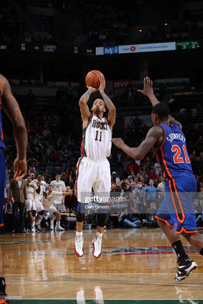 <a gi-track='captionPersonalityLinkClicked' href=/galleries/search?phrase=Monta+Ellis&family=editorial&specificpeople=567403 ng-click='$event.stopPropagation()'>Monta Ellis</a> #11 of the Milwaukee Bucks shoots against <a gi-track='captionPersonalityLinkClicked' href=/galleries/search?phrase=Iman+Shumpert&family=editorial&specificpeople=5042486 ng-click='$event.stopPropagation()'>Iman Shumpert</a> #21 of the New York Knicks on April 11, 2012 at the Bradley Center in Milwaukee, Wisconsin.