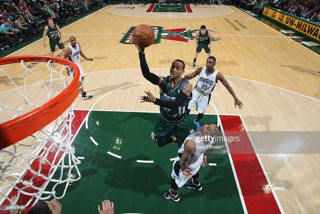 <a gi-track='captionPersonalityLinkClicked' href=/galleries/search?phrase=Monta+Ellis&family=editorial&specificpeople=567403 ng-click='$event.stopPropagation()'>Monta Ellis</a> #11 of the Milwaukee Bucks shoots against <a gi-track='captionPersonalityLinkClicked' href=/galleries/search?phrase=Jameer+Nelson&family=editorial&specificpeople=202057 ng-click='$event.stopPropagation()'>Jameer Nelson</a> #14 of the Orlando Magic on March 17, 2013 at the BMO Harris Bradley Center in Milwaukee, Wisconsin.
