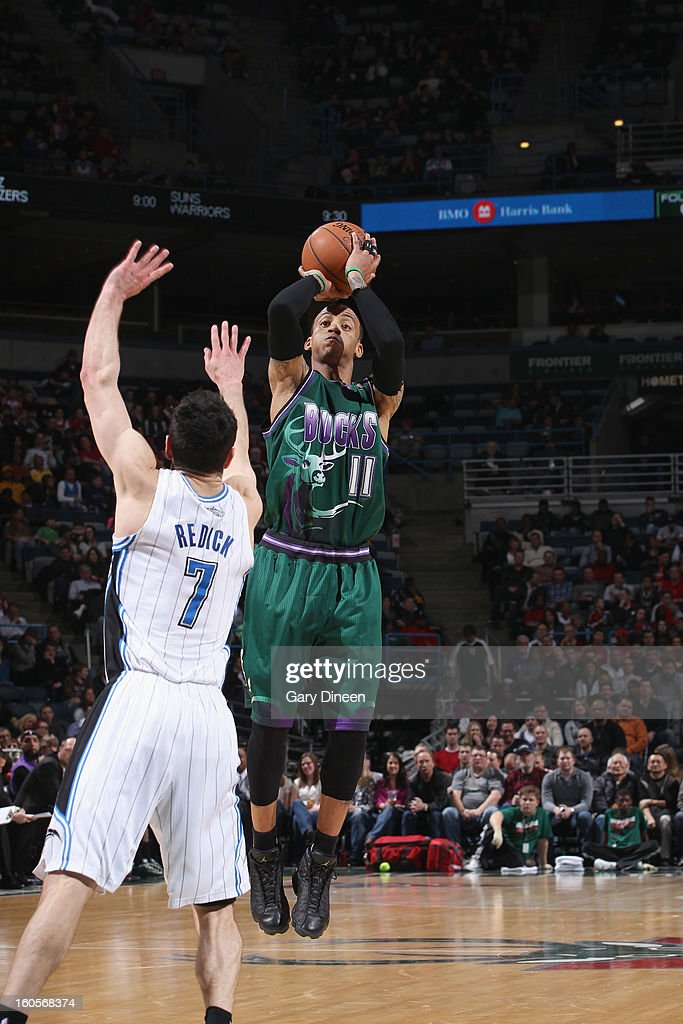 Monta Ellis #11 of the Milwaukee Bucks shoots against J.J. Redick #7 of the Orlando Magic on February 2, 2013 at the BMO Harris Bradley Center in Milwaukee, Wisconsin.