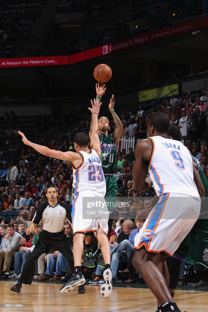 <a gi-track='captionPersonalityLinkClicked' href=/galleries/search?phrase=Monta+Ellis&family=editorial&specificpeople=567403 ng-click='$event.stopPropagation()'>Monta Ellis</a> #11 of the Milwaukee Bucks shoots against <a gi-track='captionPersonalityLinkClicked' href=/galleries/search?phrase=Kevin+Martin+-+Basketball+Player&family=editorial&specificpeople=204503 ng-click='$event.stopPropagation()'>Kevin Martin</a> #23 of the Oklahoma City Thunder on March 30, 2013 at the BMO Harris Bradley Center in Milwaukee, Wisconsin.