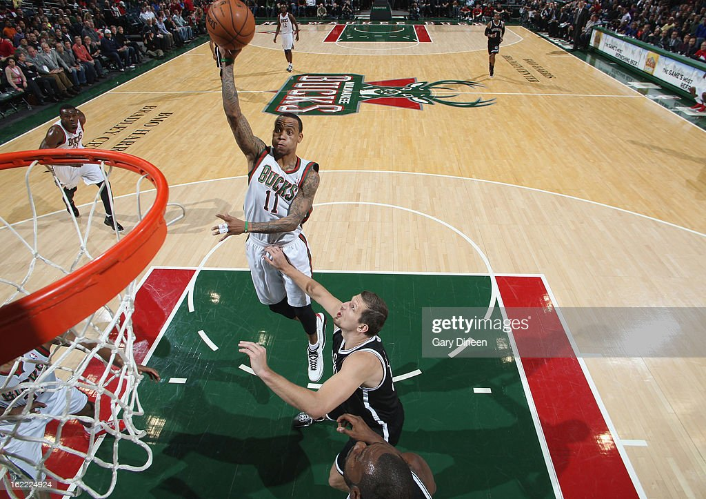 <a gi-track='captionPersonalityLinkClicked' href=/galleries/search?phrase=Monta+Ellis&family=editorial&specificpeople=567403 ng-click='$event.stopPropagation()'>Monta Ellis</a> #11 of the Milwaukee Bucks shoots against <a gi-track='captionPersonalityLinkClicked' href=/galleries/search?phrase=Mirza+Teletovic&family=editorial&specificpeople=2255667 ng-click='$event.stopPropagation()'>Mirza Teletovic</a> #33 of the Brooklyn Nets on February 20, 2013 at the BMO Harris Bradley Center in Milwaukee, Wisconsin.