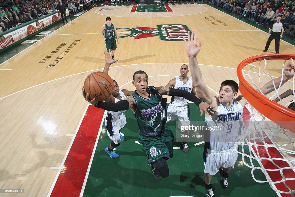 <a gi-track='captionPersonalityLinkClicked' href=/galleries/search?phrase=Monta+Ellis&family=editorial&specificpeople=567403 ng-click='$event.stopPropagation()'>Monta Ellis</a> #11 of the Milwaukee Bucks shoots against Nikola Vucevic #9 of the Orlando Magic on March 17, 2013 at the BMO Harris Bradley Center in Milwaukee, Wisconsin.